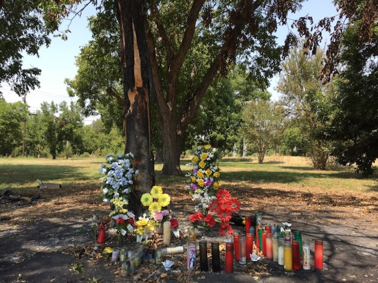 Candles and flowers mark the site of a fiery crash on Villamain Road near Mission San Juan that took the lives of two brothers. Photo by Robert Rivard