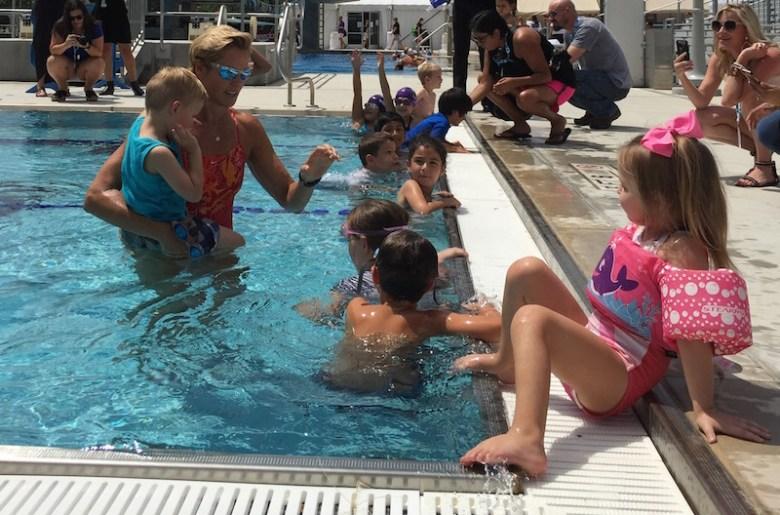 Dara Torres gives swim instruction to kids. Photo by Hunter Bates.