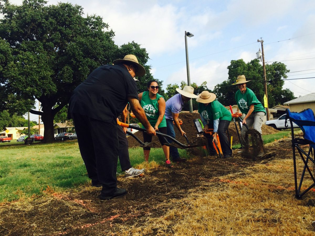 Pastor Gil, Jovanna Lopez, Angela Hartsdale, and Julia Murphy break ground with other volunteers at Collins Garden's new food forest