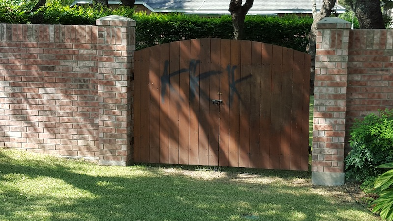 A vandalized gate on the Northside. Photo by Winslow Swart.