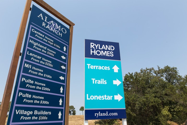 Signs advertising newly constructed neighborhoods off of Alamo Ranch Parkway. Photo by Scott Ball.