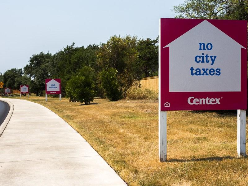 A Centex sign advertising no city taxes in Alamo Ranch. Photo by Scott Ball.