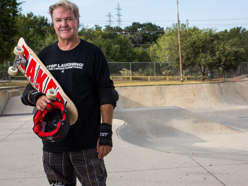 Gary Sweeney holds his skateboard for a portrait after a skate session. Photo by Scott Ball.