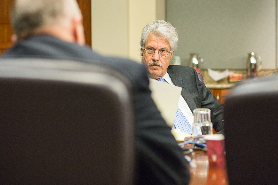 City's lead negotiator, Jeff Londa, listens as police union lawyer Ron DeLord reviews the latest police union proposal. Photo by Scott Ball.