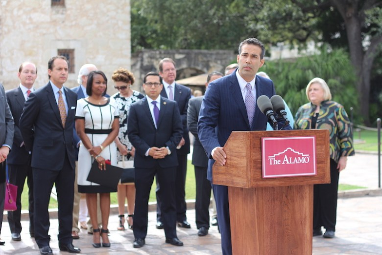 Texas Land Commissioner George Bush speaks to the crowd while Sen. José Menéndez, Mayor Ivy Taylor, Rep. Diego Bernal, and others stand behind him. Photo by Joan Vinson.