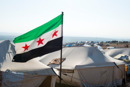 Free Syrian flag flying inside the camp for displaced persons at Atmeh, Syria. Getty Images.
