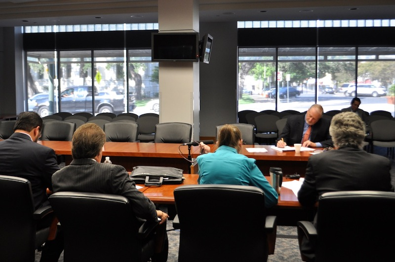 The City's negotiating team meets with the police union's lead negotiator Ron DeLord. Photo by Iris Dimmick.