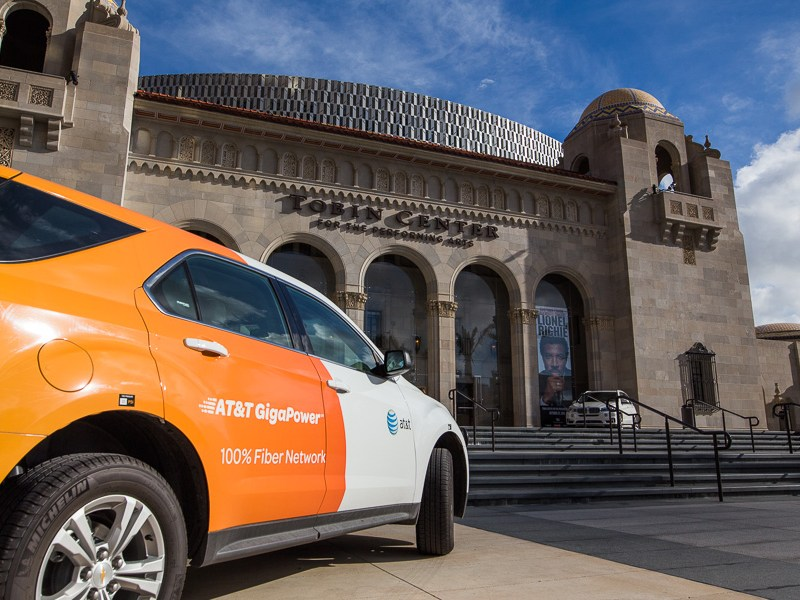 An AT&T GigaPower vehicle parked in front of the Tobin Center for the Performing Arts. Photo by Scott Ball.