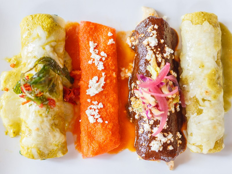 A variety of enchiladas served by La Fonda. Photo by Scott Ball.