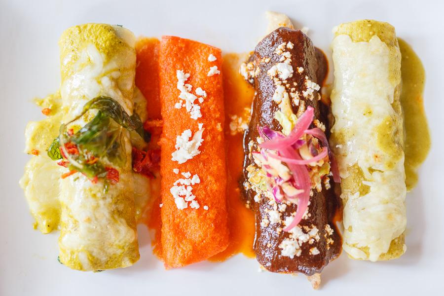 A variety of enchiladas served by La Fonda. Photo by Scott Ball.