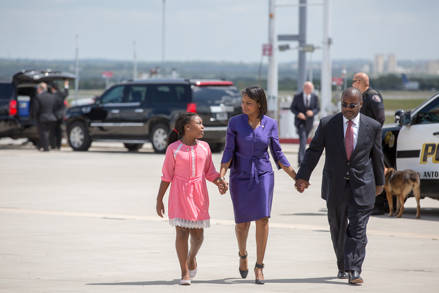 The Taylor family walks back from the runway to move onto the next location, city hall. Photo by Scott Ball.