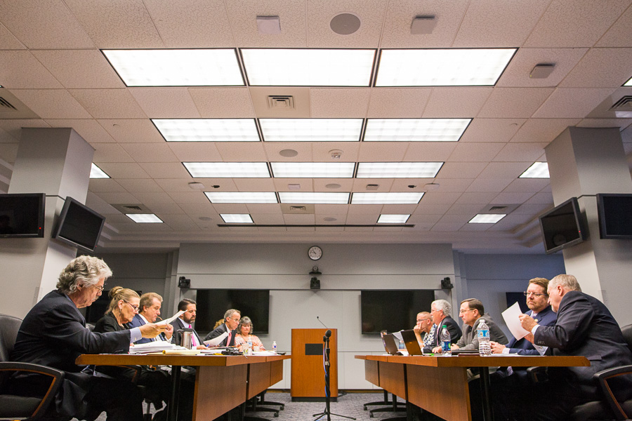 The City of San Antonio negotiation team (left) sits across from the SAPOA negotiation team (right). Photo by Scott Ball.