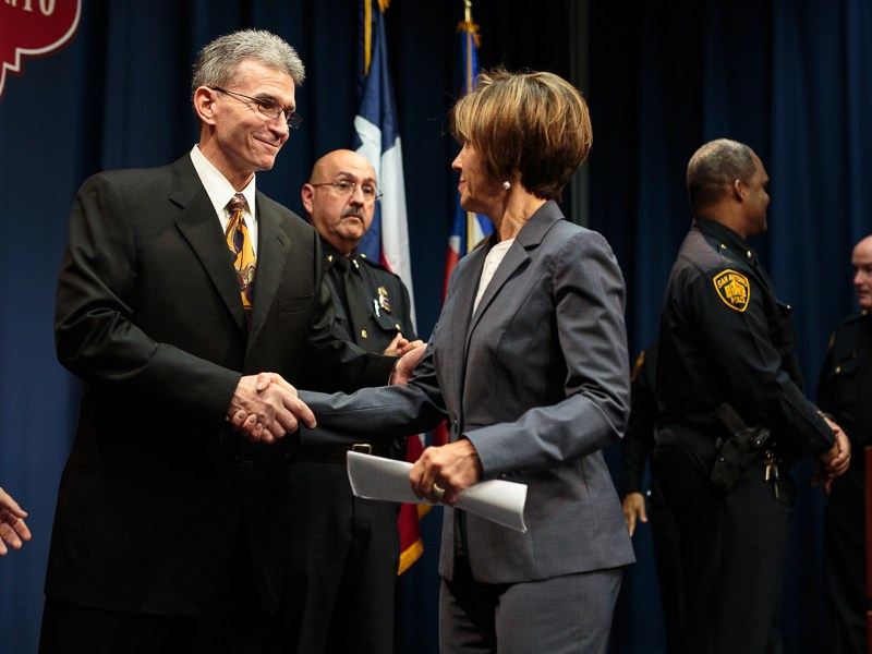 City Manager Sheryl Sculley shakes the hand of former police chief William McManus. Photo by Scott Ball.
