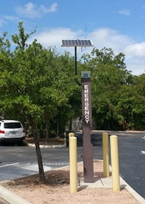 A solar emergency phone stanchion located in a parking lot at San Antonio College. Photo by Jillian Corley.