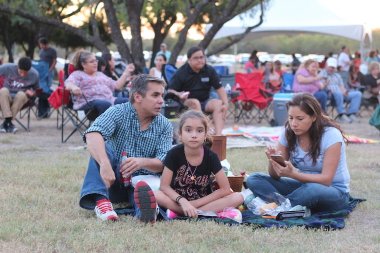 Attendees wait for the show while lounging on a blanket. Photo by Joan Vinson.