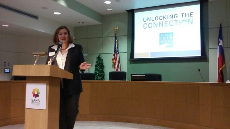 Catherine Crago, strategic initiatives manager for Austin Pathways, addresses a kickoff meeting for ConnectHome San Antonio at the San Antonio Housing Authority offices on Friday, Oct. 30, 2015. Photo by Edmond Ortiz