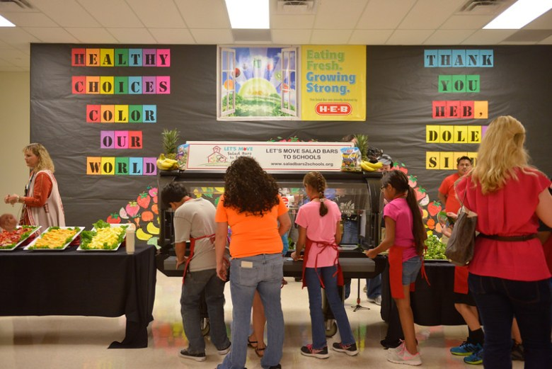 Rodriguez Elementary students in Seguin ISD test out their school's new salad bar. Photo courtesy of H-E-B.