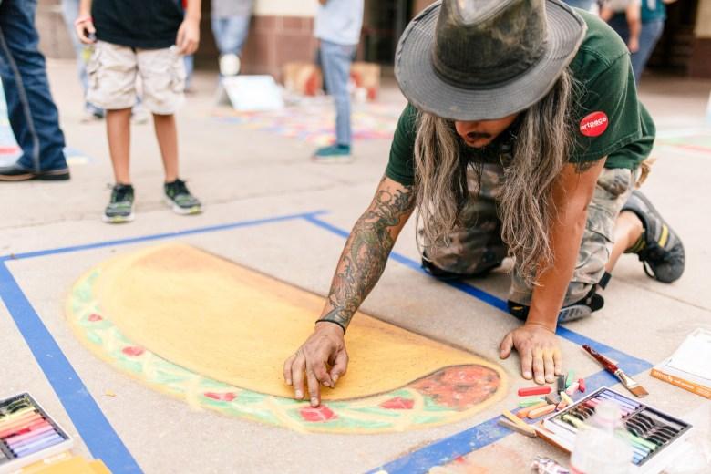 Featured Artist, John Eric DelaZerda works on his piece during Artpace's Chalk it Up 2015. (Photo: Josh Huskin)