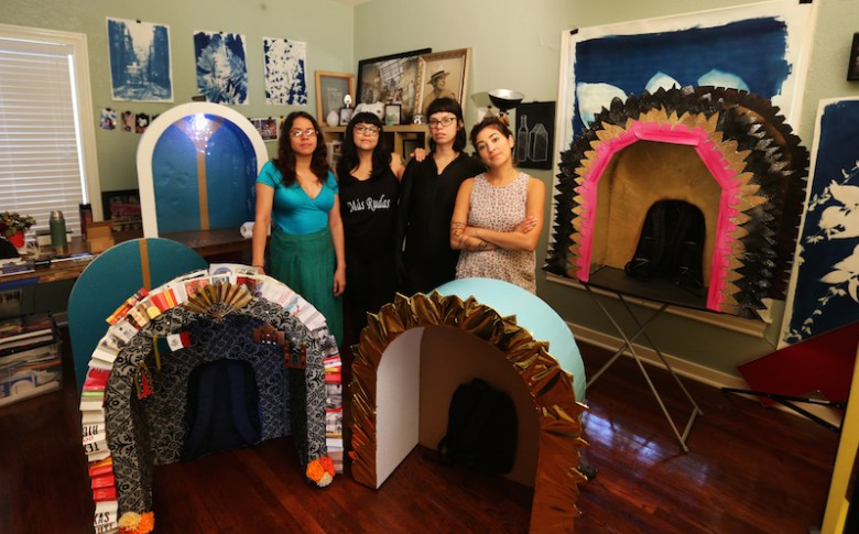 """Members of Más Rudas Art Collective stand with their Luminaria piece """"Walking Altars,"""" Photo by Marisa Hernandez."""