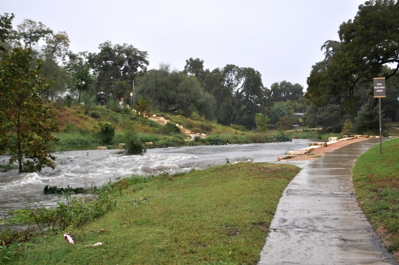 The San Antonio River floods a crossing point in Southtown. Photo by Iris Dimmick.