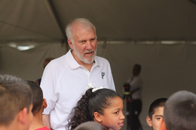 San Antonio Spurs Head Coach Greg Popovich interacts with members of the Boys & Girls Clubs of San Antonio. Photo by Joan Vinson.