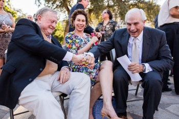 Alamo Edmoment Members Red McCombs and Gene Powell click University of Texas class rings while Alamo Endowment member Ramona Bass watches. Photo by Scott Ball.