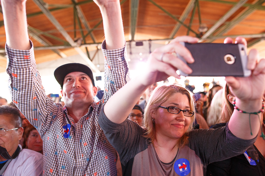 Clinton supporters use smartphones to photograph the candidate. Photo by Scott Ball.