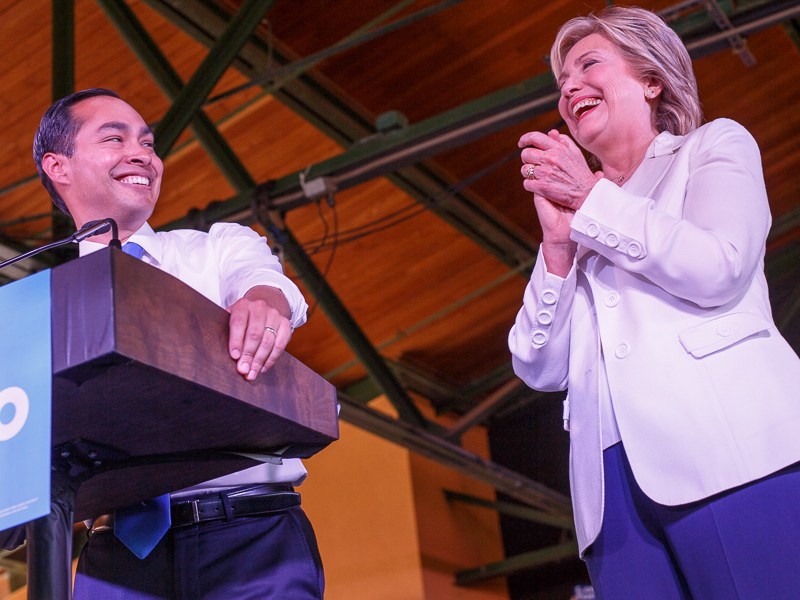 United States Secretery of Housing and Urban Development Julián Castro smiles as he mentions Hillary Clinton (right). Photo by Scott Ball.