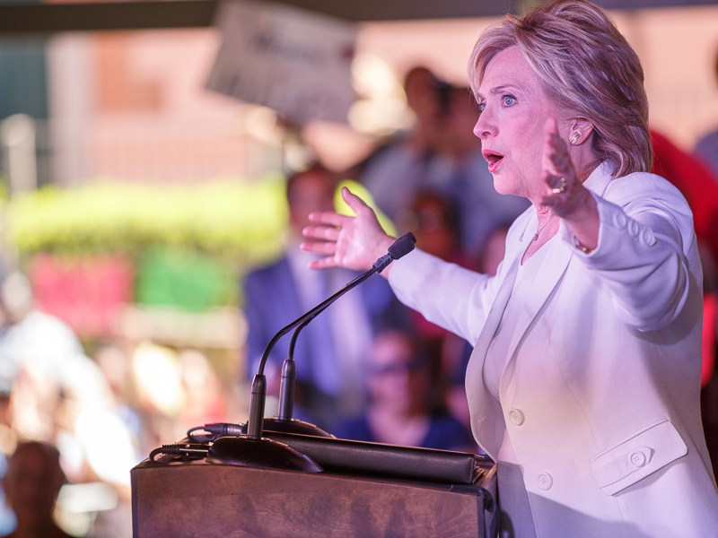 Hillary Clinton speaks to hundreds in attendance at Sunset Station. Photo by Scott Ball.