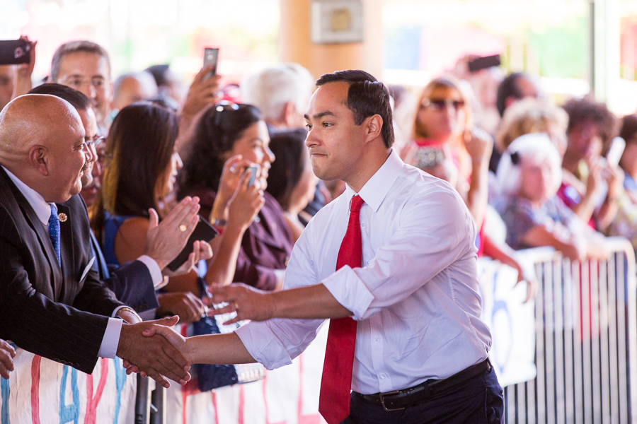 U.S. Rep Joaquin Castro shakes hands with guests as he walks to the stage. Photo by Scott Ball.