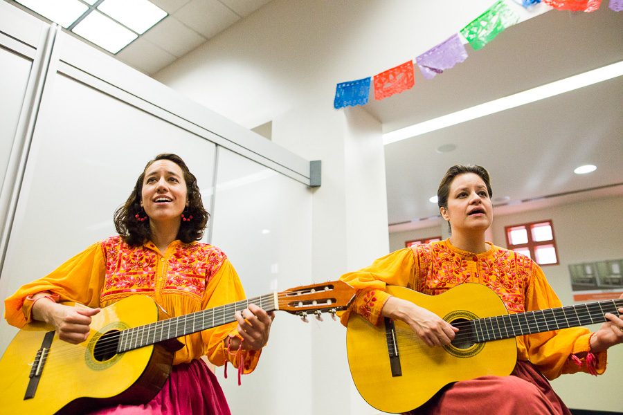Local artists perform at the future of the Lation Collection & Resource Center at the Central Library. Photo by Scott Ball.