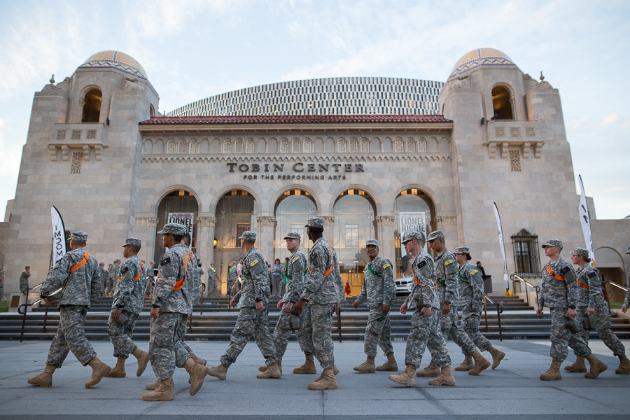 U.S. Army soldiers walk in line to the Tobin Center for the Performing Arts. Photo by Scott Ball.