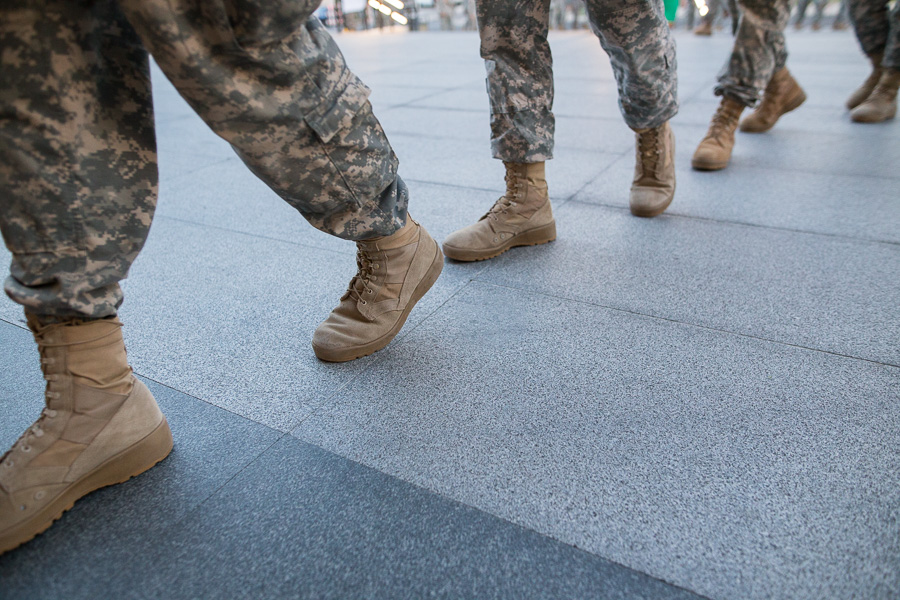 Soldiers walk in line one by one into the Tobin Center for the Performing Arts. Photo by Scott Ball.