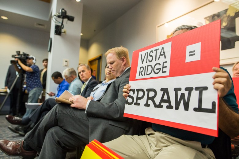 Alan Montemoyar holds up a sign in opposition to the Vista Ridge pipeline. Photo by Scott Ball.