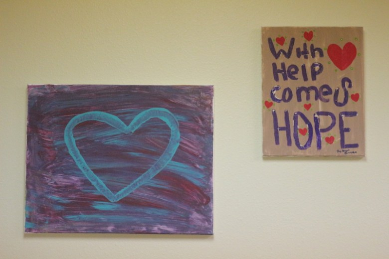 Paintings on the wall in the St. Jude's Ranch for Children San Antonio office. Photo by Joan Vinson.