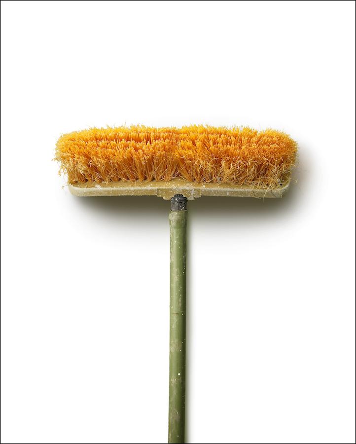 "Chuck Ramirez - Brooms: Orange Pushbroom - 2/3 photograph on archival paper, 60 x 48"". Courtesy of Ruiz-Healy Art."