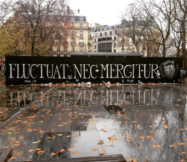 """The words """"Fluctuat Nec Mergitur"""" adorn a memorial for the victims of the Friday, Nov. 13 Paris attacks. Photo courtesy of Instagram."""