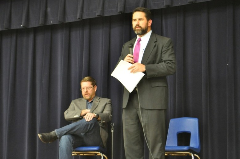 Deputy City Manager Erik Walsh speaks the crowd while SAPOA President Mike Helle looks on. Photo by Iris Dimmick.