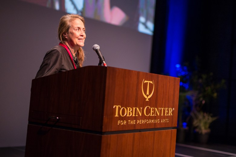 Honored artist Naomi Shihab Nye gives his acceptance speech. Photo by Scott Ball.
