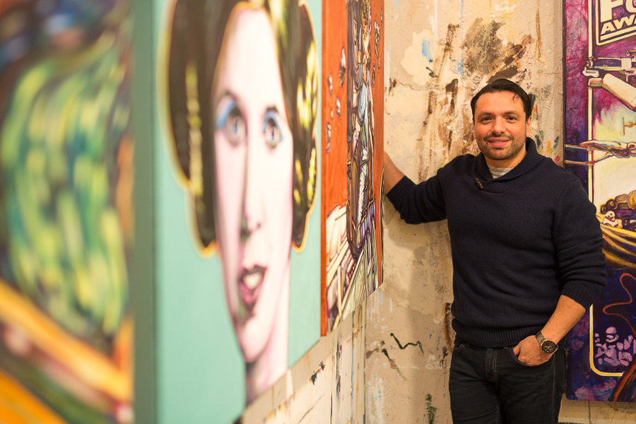 David Blancas stands for a photograph near his recent Star Wars themed work in his South Presa Street studio. Photo by Scott Ball.