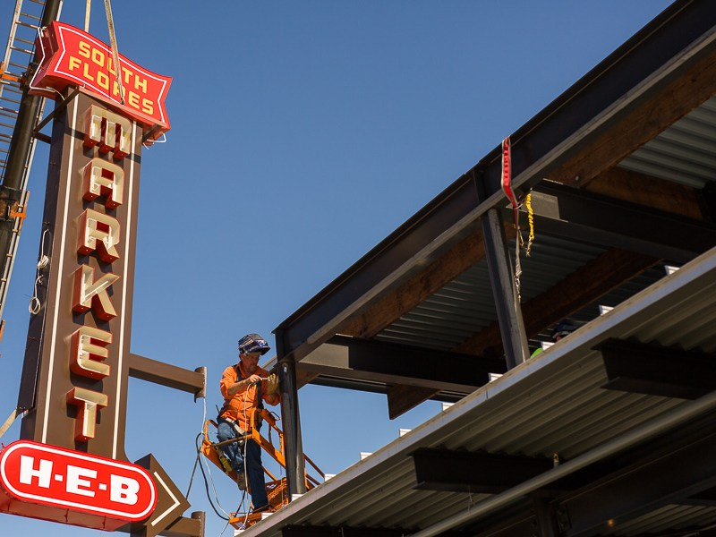 Comet Signs welder Bernie Cromer prepares his materials to weld the H-E-B South Flores Market sign. Photo by Scott Ball.