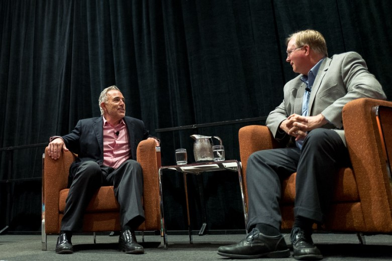 Robert Rivard (left) speaks with Rackspace Co-Founder Graham Weston at the 2015 Health and The Built Environment Conference. Photo by Scott Ball.