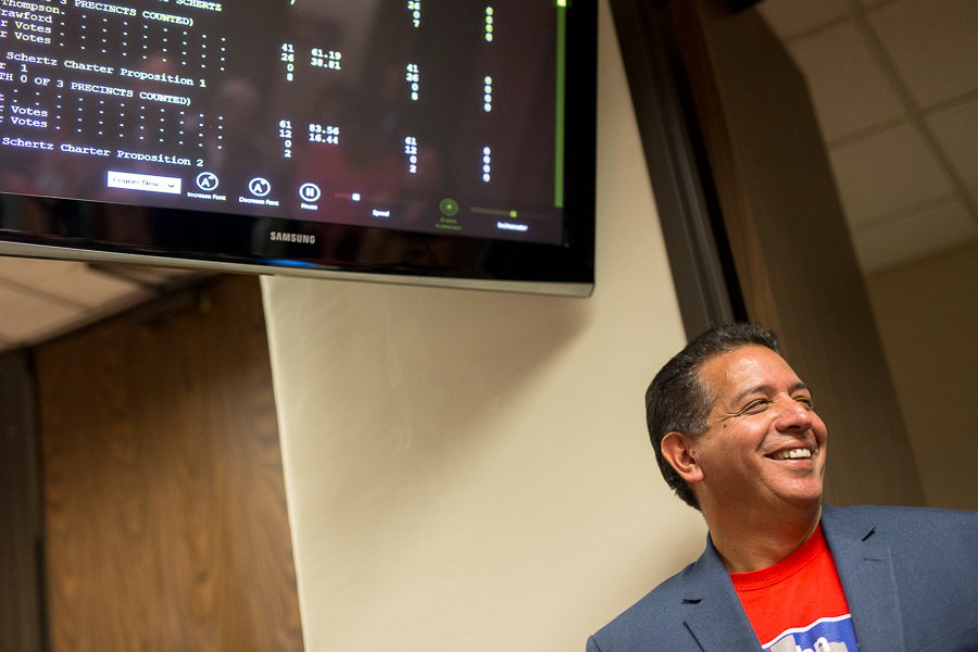 John Lujan smiles as polling goes in his favor. Photo by Scott Ball.