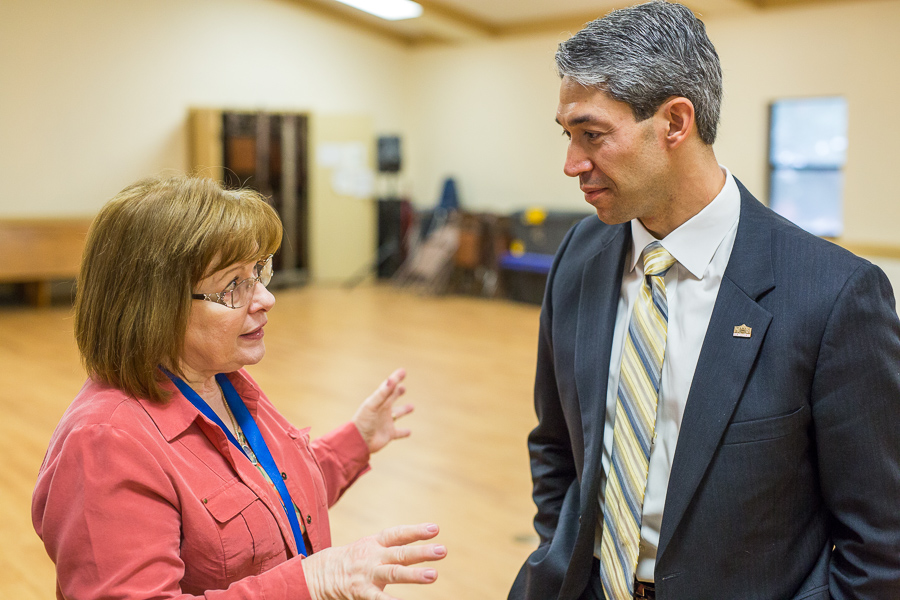 Margaret Costantino Director of Center for Refugee Services talks about the event with Councilmember Ron Nirenberg (D8). Photo by Scott Ball.