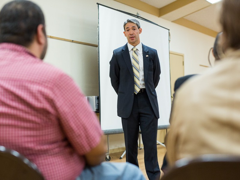 District 8 Councilmember Ron Nirenberg speaks with refugees. Photo by Scott Ball.