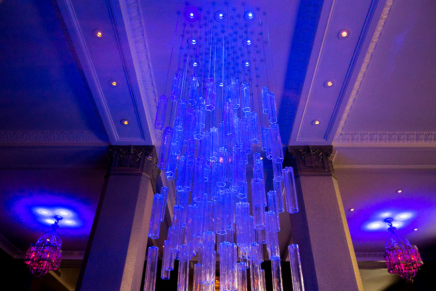 The centerpiece chandelier above the bar at Rebelle. Photo by Scott Ball.