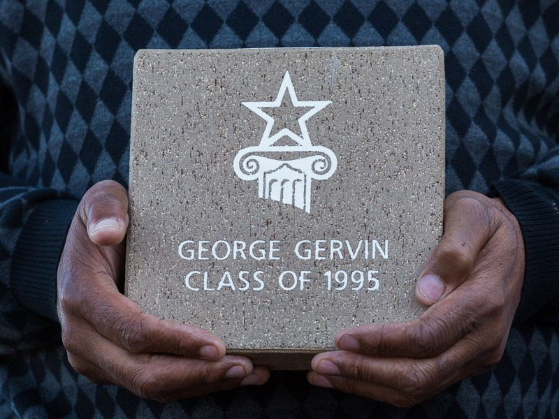 George Gervin holds the commemorative brick that will be laid in the Hall of Fame Plaza. Photo by Scott Ball.