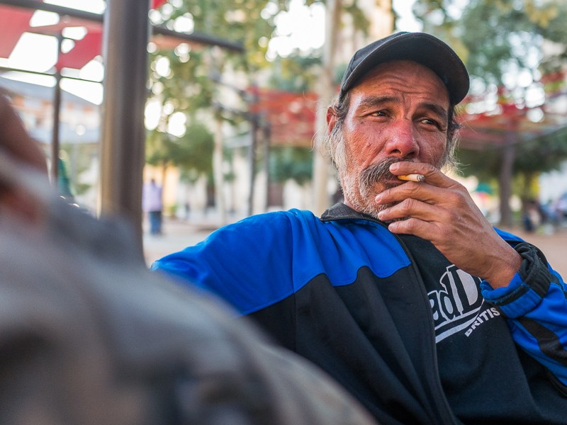 San Antonio resident Henry Gonzales takes a smoke break in Main Plaza. Photo by Scott Ball.