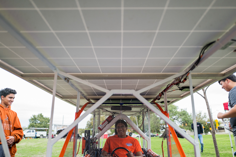 Student Jean-Luc Yohi sits in the solar powered vehicle built by Madison High School students. Photo by Scott Ball.