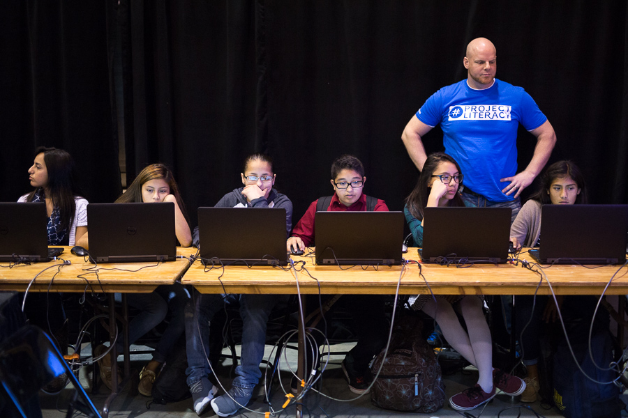 Students participate in The Hour of Code popup classroom as team member Andrew McCurdy supervises. Photo by Scott Ball.